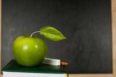 Apple against blackboard Stock Photo
