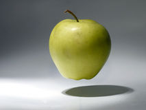 Apple in the air Royalty Free Stock Images