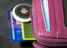 Free Apple AirTag Being Inserted In A Small Credit Card Wallet Stock Photos - 218540433