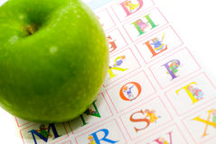 Apple and the alphabet. Royalty Free Stock Photos