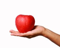 Apple And Hand. Royalty Free Stock Photography