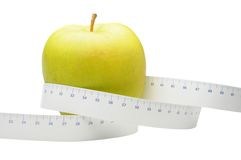 Apple And Measure Tape Royalty Free Stock Photo