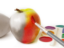 Apple And Paints Royalty Free Stock Image