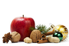 Apple anise nuts christmas balls and a branch Royalty Free Stock Image