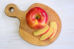 Apple on apple shaped board Stock Image