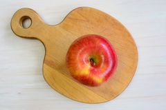 Apple on apple shaped board Stock Images