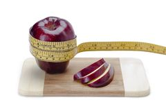 Apple and apple slices Royalty Free Stock Images