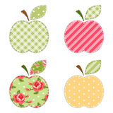 Apple applique. Vintage apple applique with roses, gingham, polka dot and striped fabrics Stock Image