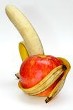 Apple arms banana. Apple in the arms of a banana on white background. Healthy lifestyle Royalty Free Stock Image