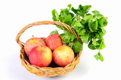 Apple and Asiatic in basket on white background Royalty Free Stock Images