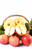 Apple and Asiatic in basket on white background Royalty Free Stock Photos