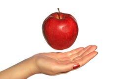 Apple au-dessus d'une main Images libres de droits
