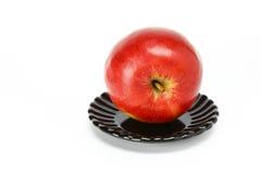 Apple auf einer Platte Stockfotos