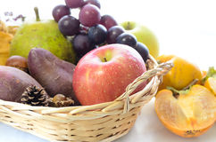 Apple and autumn fruits in a basket Stock Photos