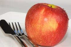 Apple avec des couverts Image stock