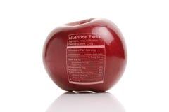 Apple avec des faits de nutriton Photographie stock libre de droits