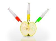 Apple avec des seringues Photo stock