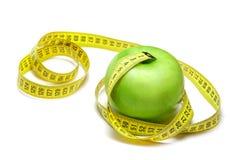 Apple avec la bande de centimètre Image stock