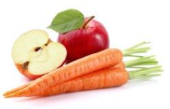 Apple avec la carotte Photos libres de droits