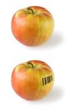 Apple avec le code barres images stock