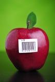 Apple avec le code barres photographie stock