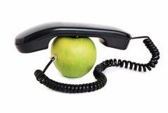 Apple avec le combiné téléphonique et le fil Image stock