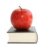 Apple avec le livre Image libre de droits