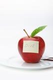 Apple avec une note de papier Image libre de droits