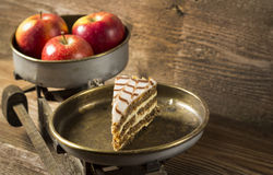 Apple in balance. With cake on wooden background Stock Photo