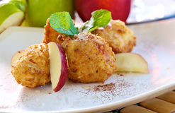 Apple balls with coco. Apple pieces covered with coconut pie Stock Image
