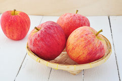 Apple on bamboo basket. Royalty Free Stock Photo