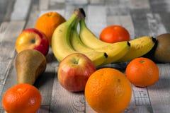Apple, banan, russet, orange, mandarin. Apple banan russet orange mandarin on the table royalty free stock images