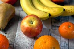 Apple, banan, russet, orange, mandarin. Apple banan russet orange mandarin on the table stock photo