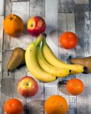 Apple, banan, russet, orange, mandarin royalty free stock photos