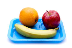 Apple and banana with orange on blue plate Stock Photo