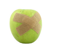 Apple With Bandages Royalty Free Stock Images