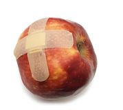Apple with bandaid. Isolated over white Stock Photo