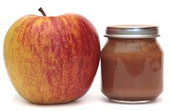 Apple and the Bank of baby food  on a white background. Applesauce. Apple and  Bank of baby food Stock Image