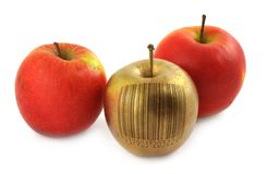 Apple with bar code. Golden apple with bar code isolated on white background (bar code is fake, no copyright infringement Royalty Free Stock Image