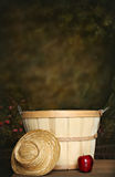 Apple Basket. Image with Straw hat, use as a digital photography prop royalty free stock photo