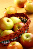 Apple and basket Stock Photography