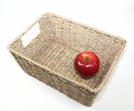Apple in a basket Royalty Free Stock Photo