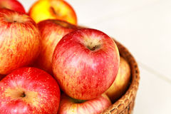 Apple in the basket Royalty Free Stock Photos