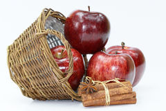Apple basket and cinnamon Stock Photo
