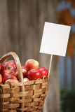 Apple basket closeup with sign Royalty Free Stock Image