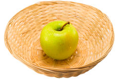 Apple in a basket Royalty Free Stock Image