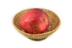 Apple in basket Stock Photos