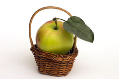 Apple in a basket. Royalty Free Stock Image