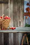 Apple basket on a table Royalty Free Stock Photography