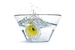 Apple bath. Apple falling into a container of water Stock Images